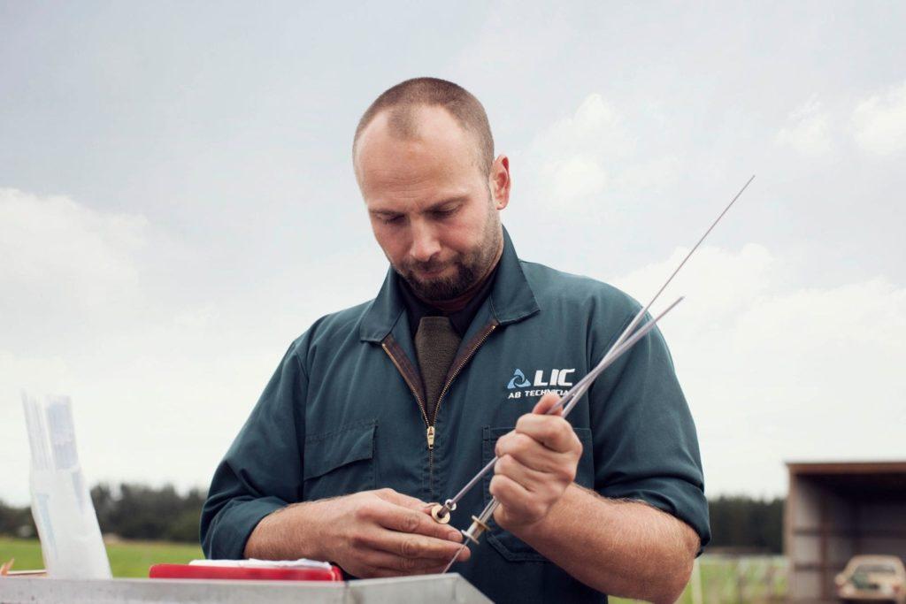 An LIC artificial insemination technician on a dairy farm